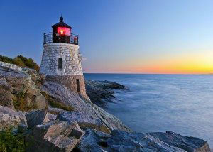 Beautiful lighthouse by the ocean at sunset www.njcharters.com