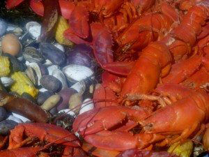 Butter Island Lobster Boil steaming lobsters, mussels, clams, corn, potatoes, sausage