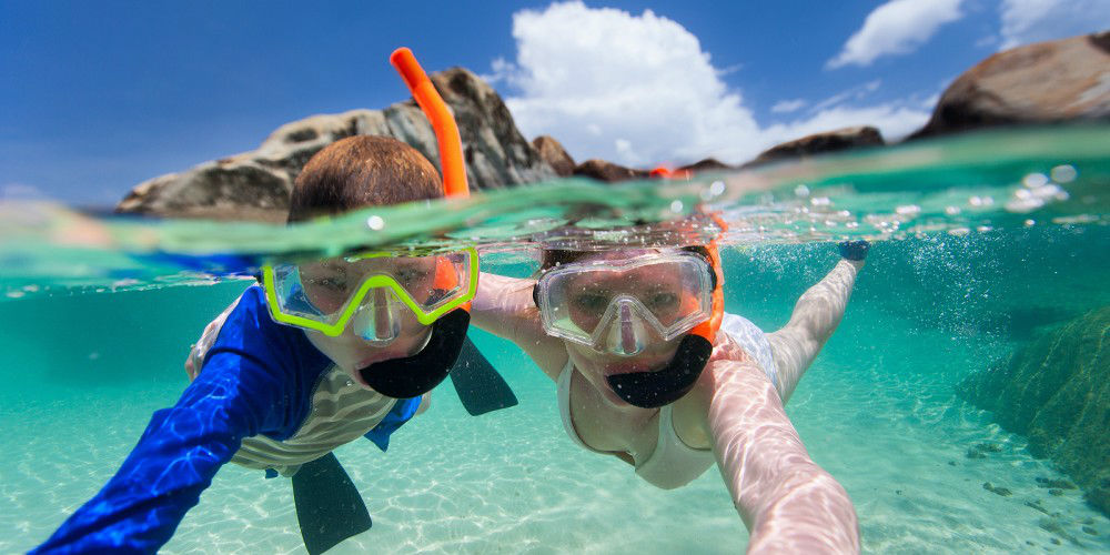 Split photo of mother and son family snorkeling in turquoise oce