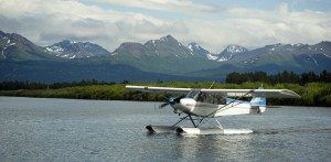 Float Plane comes in to moor after landing in alaska