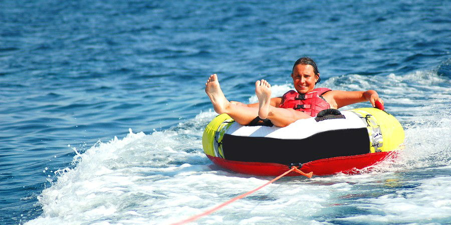 young girl on a tube on adriatic waters in croatia