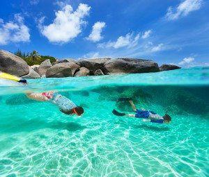 snorkeling in turquoise ocean water at tropical island of Virgin Gorda, British Virgin Islands, Caribbean