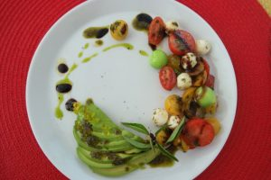 Balsamic Herb Marinated Tomato, Basil Mozzarella Salad with Olive Oil Caviar