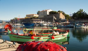 The colorful fishing boat in Ajaccio port Corsica island France.