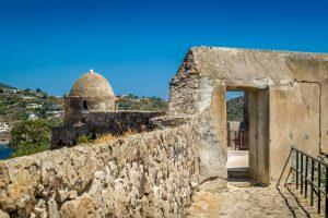 Ancient fort walls at Lipari island harbor., Italy