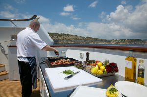Chef Prepares cuising on Luxury Yacht Charter www.njcharters.com