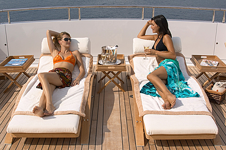 Lounging on Deck on Luxury Yacht Charter - Yacht Charter Lifestyle www.njcharters.com.jpg