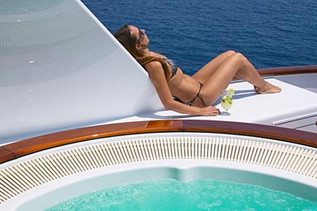 Luxury Yacht Charter -Sunbathing by Jacuzzi- Yacht Charter Lifestyle www.njcharters.com.jpg