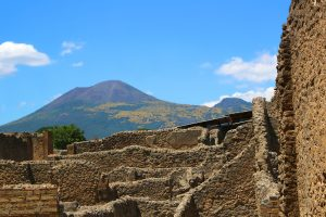 View of ruins in the old city of Pompeii Italy with Mount Vesuvius in the background