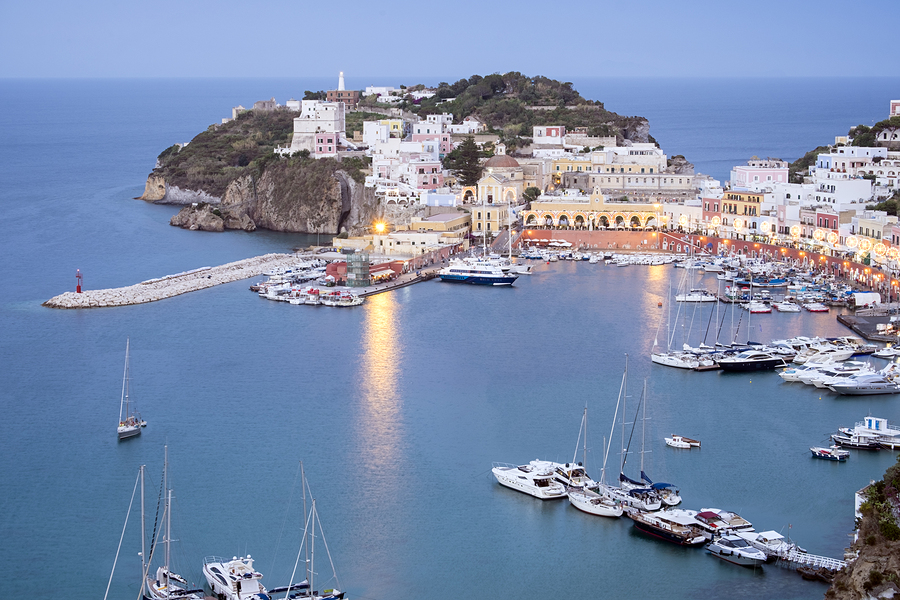 Ponza town harbour captured at blue hour.