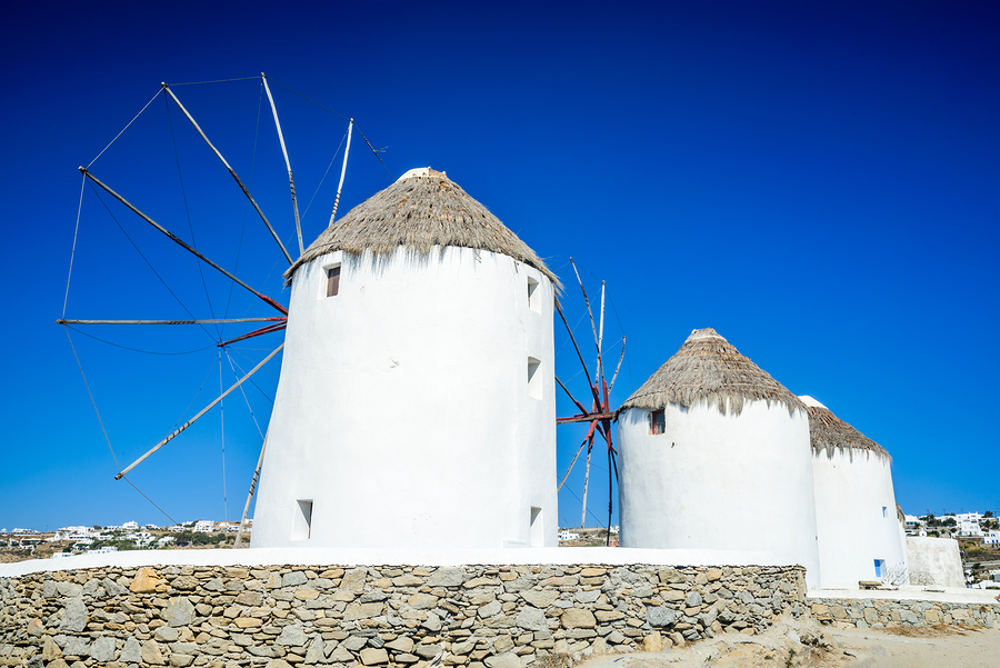 Mykonos Greece. Windmills and Little Venice waterfront houses considered one of the most romantic places on the Cyclades Islands.