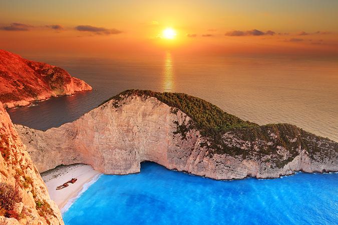 Zakynthos Sunset over Shipwreck Beach www.njcharters.com.jpg