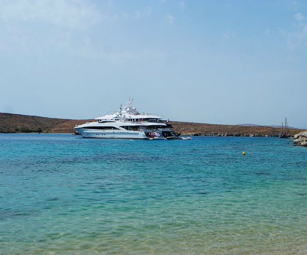 Greece motor yachts at anchor for beach barbecue njcharters.com