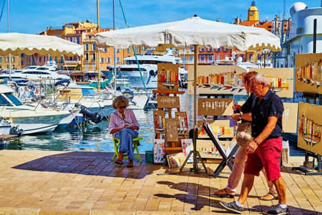 Artists on the quay in Vieux Port St Tropez France njcharters.com