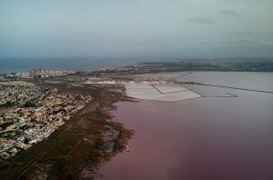 Torrevieja Cityscape and Las Salinas Pink Lake at Sunset