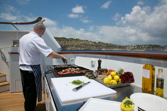 Chef Prepares Cuisine on Luxury Yacht Charter
